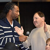 (Brad Davis/The Register-Herald) Fan and banquet attendee Tony Mamone asks Arizona Cardinals receiver Larry Fitzgerald a question during a Q&A session during the Big Atlantic Classic Tip-Off Banquet Sunday afternoon at the Beckley-Raleigh County Convention Center.