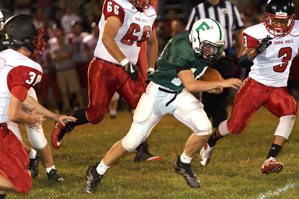 Fayetteville quarterback, Tristian Coots escapes the Oak Hill defense. Chad Foreman for the Register-Herald