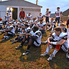 (Brad Davis/The Register-Herald) Indy coaches and players have a final group meeting outside of the visitors' locker room prior to their road game at Summers County Friday night in Hinton.