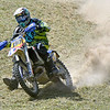 (Brad Davis/The Register-Herald) A competitor tears across a section of the course during Sprint Enduro Series dirt bike racing Saturday afternoon at Hidden Valley Golf in Glen Daniel.