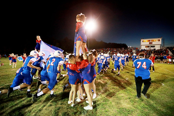Midland Trail football team rushes onto the field prior to kickoff of their football game against Fayetteville Friday in Hico. (Chris Jackson/The Register-Herald)