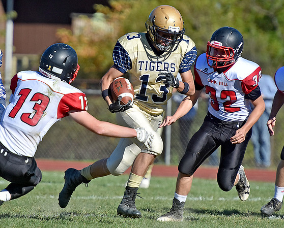 (Brad Davis/The Register-Herald) Shady Spring's Cole Honaker carries the ball between Oak Hill defenders Christian Sanger, left, and Scott Wilshire Saturday afternoon in Shady Spring.