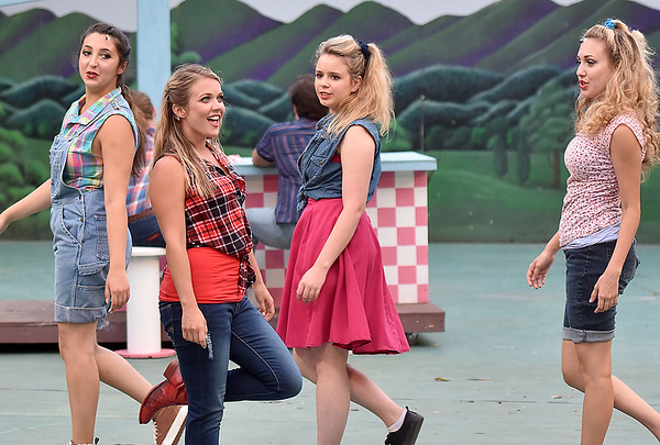 (Brad Davis/The Register-Herald) Ariel Moore (2nd from left), played by Molly Ann Ross, during a scene from Theatre West Virginia's Footloose at Grandview Park's Cliffside Amphitheatre.