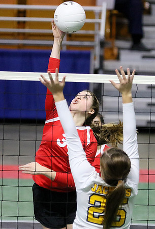 (Brad Davis/The Register-Herald) Greater Beckley Christian's Lydia Jordan goes for a kill as Moorefield's Hanna Carlson tries to block it during State Volleyball Tournament action Friday afternoon at the Charleston Civic Center.