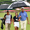 Davis Love III, right, walks down the number 1 fairway with Aaron Denny, left, caddy, and Mary Denny, during the the First Tee Scramble held on the Old White course at The Greenbrier.<br /> (Rick Barbero/The Register-herald)