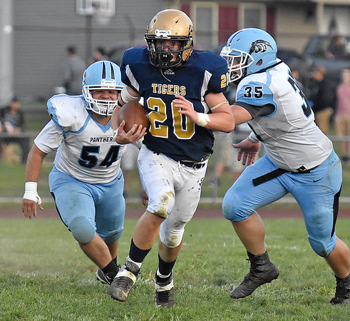 (Brad Davis/The Register-Herald) Shady Spring's Isaac Harvey rumbles past Lincoln County's Caden Weaver, left, and Jacob Neuenschwander Friday night in Shady Spring.