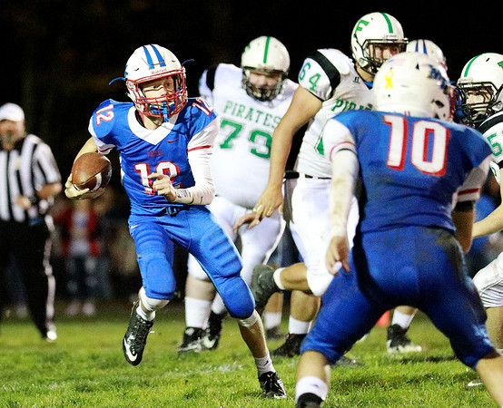 Midland Trail quarterback Austin Isacs (12) carries the ball during their football game against Fayetteville Friday in Hico. (Chris Jackson/The Register-Herald)