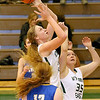 (Brad Davis/The Register-Herald) Wyoming East's Emily Saunders rushes in to grab a defensive rebound from the air over teammate Haley Butcher and between St. Joeseph Central's Abigail Lee, near, and Myra Hall (hidden behind Saunders) during the Lady Warriors' win over the Irish Friday night in New Richmond.