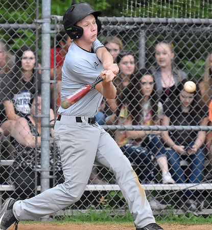 (Brad Davis/The Register-Herald) Wyoming East's McQuade Canada hits a ball in play off Independence starting pitcher Nick Kostenko Friday evening in Coal City.