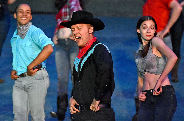 (Brad Davis/The Register-Herald) Cowboy Bob (middle), played by Bradley McBribe, during a scene from Theatre West Virginia's Footloose at Grandview Park's Cliffside Amphitheatre.