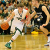(Brad Davis/The Register-Herald) Wyoming East's Corey Mckinney drives as Westside's Broc Smith defends during the second boys meeting of the year in the battle for Wyoming County Friday night in New Richmond.