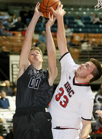 (Brad Davis/The Register-Herald) Independence's Nick Kostenko drives to the basket as Greater Beckley Christian's Garrett Matherly defends Friday night at the Beckley-Raleigh County Convention Center.