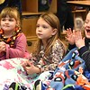 "Eden Biere, left, Kelly Brandstetter, Adalee Crawford, T.J. Parson and Andrew Canady, are wrapped up in their blankets listening to, Linda Cole, co-president Fayette Co. chapter Read Aloud West Virginia, read ""Giraffes Can't Dance"" book to pre-k students during the Snuggle & Read program held at Mount Hope Elementary School Wednesday morning.<br /> (Rick Barbero/The Register-Herald)"