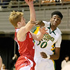 (Brad Davis/The Register-Herald) Parkersburg's Jake Johnson is fouled by Greenbrier East's Rahzell Godfrey as he drives to the basket during Big Atlantic Classic action Saturday night at the Beckley-Raleigh County Convention Center.