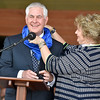 (Brad Davis/The Register-Herald) United States Secretary of State Rex Tillerson has a Boy Scouts hankerchief placed around his neck by his wife Renda St. Clair as he wraps up a speech as the guest of honor during a ceremony for the unvieling of plans for a center named for him on the grounds of the Bechtel Summit Reserve Friday afternoon.