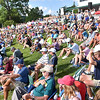 (Brad Davis/The Register-Herald) A large crowd gathers along the hillside surrounding the #18 green to watch the top finishing golfers finish up their rounds during final round Greenbrier Classic action Sunday afternoon in White Sulphur Springs.