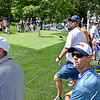 (Brad Davis/The Register-Herald) Fans watch the professionals blast off from the #12 tee box during second round Greenbrier Classic action Friday afternoon in White Sulphur Springs.