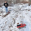 (Brad Davis/The Register-Herald) 14-year-old Joe Watson tears through the snow in a 1/10 scale, radio controlled pickup truck, one of several high performance R.C. cars that he owns Sunday afternoon on a homemade dirt track near his Wyco Hollow Road home.