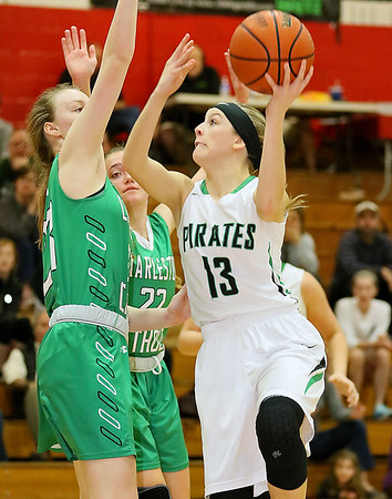 (Brad Davis/The Register-Herald) Fayetteville's Autumn Hill drives to the basket as Charleston Catholic's Elizabeth Kay defends during the Pirates' loss to the Irish Thursday night in Oak Hill.