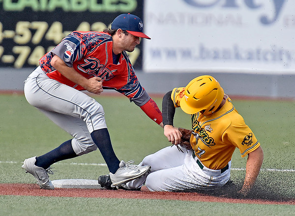 (Brad Davis/The Register-Herald) Miners baserunner Austin Norman beats Chillicothe shortstop Neil Lambert's tag as he steals 2nd base during the 1st inning of a loss to the Paints Sunday afternoon at Linda K. Epling Stadium.