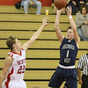 (Brad Davis/The Register-Herald) Greenbrier West's Noah Midkiff pulls up for a jumper as Independence defender Logan Stump defends Friday night in Coal City.