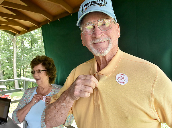 (Brad Davis/The Register-Herald) Paul Holstein, a proud Lilly family member through marriage, shows off a special sticker he and wife Leona Lilly-Holstein received after doing some historical digging on their family tree at the Lilly genealogical research booth during the annual Lilly Family Reunion Saturday afternoon near Ghent.