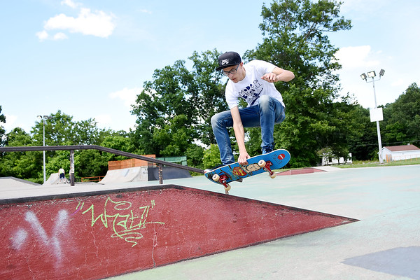 """Preston Canterbury, from Oak Hill, does an """"Early-Side-180"""" at the Freedom Skae Park in Beckley Monday. (Chris Jackson/The Register-Herald)"""