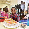 (Brad Davis/The Register-Herald) 8-year-old 2nd grader R.J. Cobbs notices the camera and smiles during a special Soul Food Luncheon Friday morning at Stratton Elementary School.