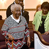 (Brad Davis/The Register-Herald) Eunice Fleming, left, the last surviving teacher from Dubois High School in Mount Hope, stands as she's one of a handful honored during Heart of God Ministries' Black History Month celebration Sunday evening.