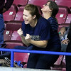 (Brad Davis/The Register-Herald) A Greenbrier West family member reacts to events on the court against East Hardy during State Volleyball Tournament action Friday morning at the Charleston Civic Center.