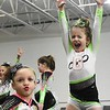 Makynlee Lewis, left, and  Kaidence Donnelly, with GymFinity All-Stars team Cosmo, prepare for a  traveling cheerleading competition.