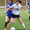 (Brad Davis/The Register-Herald) Shady Spring's Meredith Gwinn battles for possession with Princeton's Laken Dye Thursday night at the YMCA Paul Cline Memorial Sports Complex.