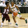 (Brad Davis/The Register-Herald) Greenbrier East's Kiara Smith drives as Woodrow Wilson's Tyjere Underwood during Big Atlantic Classic action Thursday night at the Beckley-Raleigh County Convention Center.