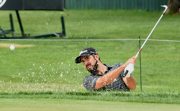 Mark Hubbard hits from the trap on the 17th hole during the first round of The Greenbrier Classic.<br /> (Rick Barbero/The Register-Herald.com