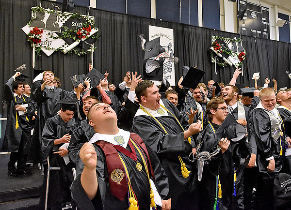 (Brad Davis/The Register-Herald) Caps fly at the conclusion of Westside High School's 2017 Commencement Ceremony Sunday afternoon in Clear Fork.