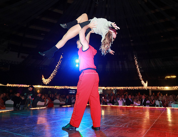 Orlando Usan and Kim Shingledecker perform during the 6th annual United Way of Southern West Virginia's Dancing With the Stars at the Beckley-Raleigh County Convention Center in Beckley on Friday. (Chris Jackson/The Register-Herald)