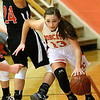 (Brad Davis/The Register-Herald) Summers County's Hannah Taylor drives around Chapmanville's  Kaylee Blair (#24) along the baseline during the Lady Bobcats' win over the Tigers Saturday night in Hinton.