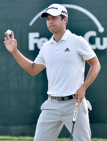(Brad Davis/The Register-Herald) Greenbrier Classic winner Xander Schauffele waves to the crowd after finishing up his final round during the Greenbrier Classic Sunday afternoon in White Sulphur Springs.