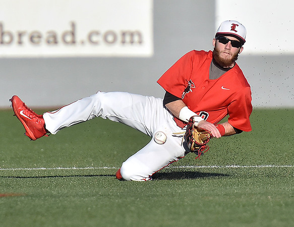 (Brad Davis/The Register-Herald) Liberty 2nd baseman Tyler Mullens slides to knock down a sharp ground ball during the Raiders' game against Nicholas County Wednesday evening at Linda K. Epling Stadium.