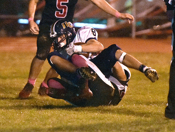 (Brad Davis/The Register-Herald) Nicholas County's Nick Kiser rolls into the endzone for a touchdown as he's tackled by PikeView defender Evan Rose Friday night in Gardner.