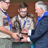 (Brad Davis/The Register-Herald) Scouts present United States Secretary of State Rex Tillerson with a smaller replica of the bronze statue of him unvieled during Friday's ceremony at the Bechtel Summit Reserve.