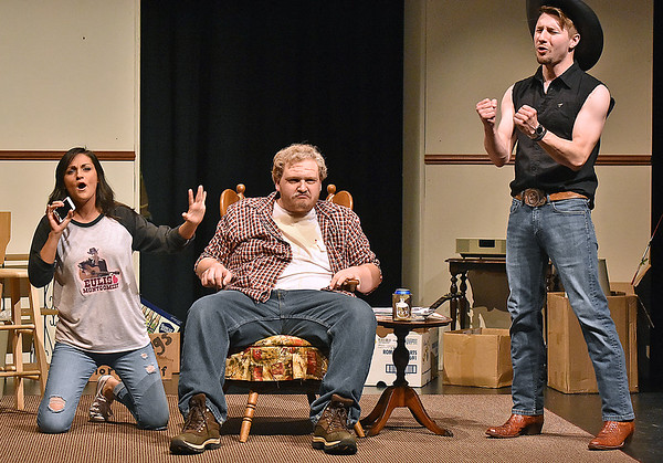 "(Brad Davis/The Register-Herald) Out of work coal truck driver Jim Cunningham (middle), played by Zach Bolon, is having a hard time tolerating his daughter Sissy's (played by Ashley Traybor) favorite country singer Eulis Montgomery, played by Korey Tedder, during a scene from ""FRACK!"" Saturday night at The Raleigh Playhouse & Theatre, a musical comedy written, produced and performed from the ground up entirely by Beckley area talent. Performances are still upcoming with shows running at The Raleigh on Thursday June 22, Friday, June 23 and Saturday, June 24, all at 7:00 p.m. Visit  <a href=""http://www.Frackmusical.com"">http://www.Frackmusical.com</a> for more info on the production."