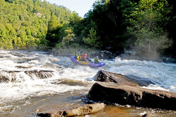 A group of rafters naviagte Pillow Rock rapids on the 2017 opening day of Gauley Season Friday.  (Chris Jackson/The Register-Herald)