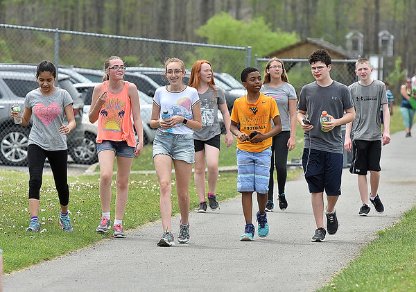 (Brad Davis/The Register-Herald) A group of young participants finish up the 5K Fun Run/Walk portion during the YMCA Healthy Kids Day event Saturday afternoon at the YMCA Paul Cline Memorial Sports Complex.