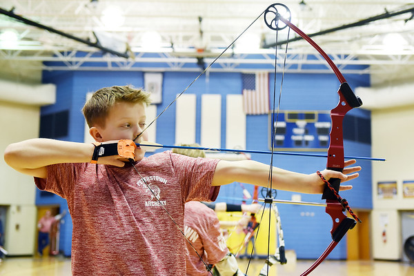 David Taylor, 10, who is on the Peterstown Elementary Archery Team, lines up a shot during a competition at Shady Spring Middle School Saturday. (Chris Jackson/The Register-Herald)
