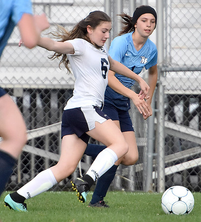 (Brad Davis/The Register-Herald) Shady Spring's Emily Stevens rushes up the field with the ball as Midland Trail's Tabitha Gill defends Thursday evening at the YMCA Paul Cline Memorial Soccer Complex.