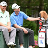J.B. Homes, left and John Taylor, rest on the 12th hole during the first round of The Greenbrier Classic.<br /> (Rick Barbero/The Register-Herald.com