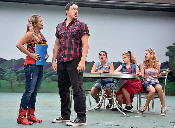 (Brad Davis/The Register-Herald) Ariel Moore, played by Molly Ann Ross, and boyfriend Chuck Cranston, played by Chris Phillips during a scene from Theatre West Virginia's Footloose at Grandview Park's Cliffside Amphitheatre.