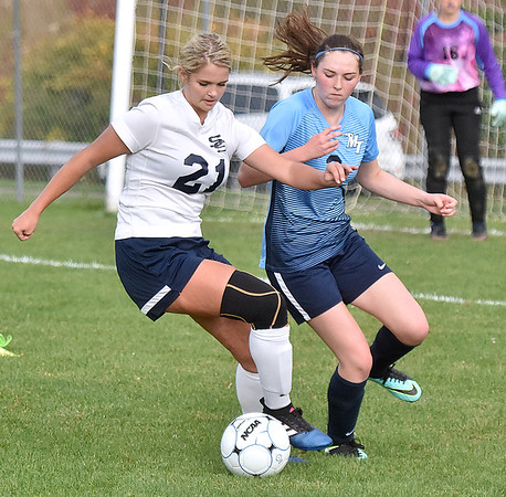 (Brad Davis/The Register-Herald) Shady Spring's Izzy Pack battles for possession with Midland Trail's Martina Moore Thursday evening at the YMCA Paul Cline Memorial Soccer Complex.