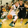 (Brad Davis/The Register-Herald) Wyoming East's Johnathan Sims drives as Westside's Shane Jenkins defends during the second boys meeting of the year in the battle for Wyoming County Friday night in New Richmond.